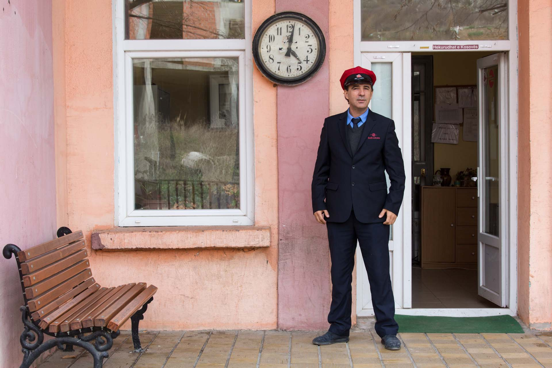 Milaim, the manager of Pristina railway station, in the capital of Kosovo, was pleased to be photographed. The clock stopped four years ago.
