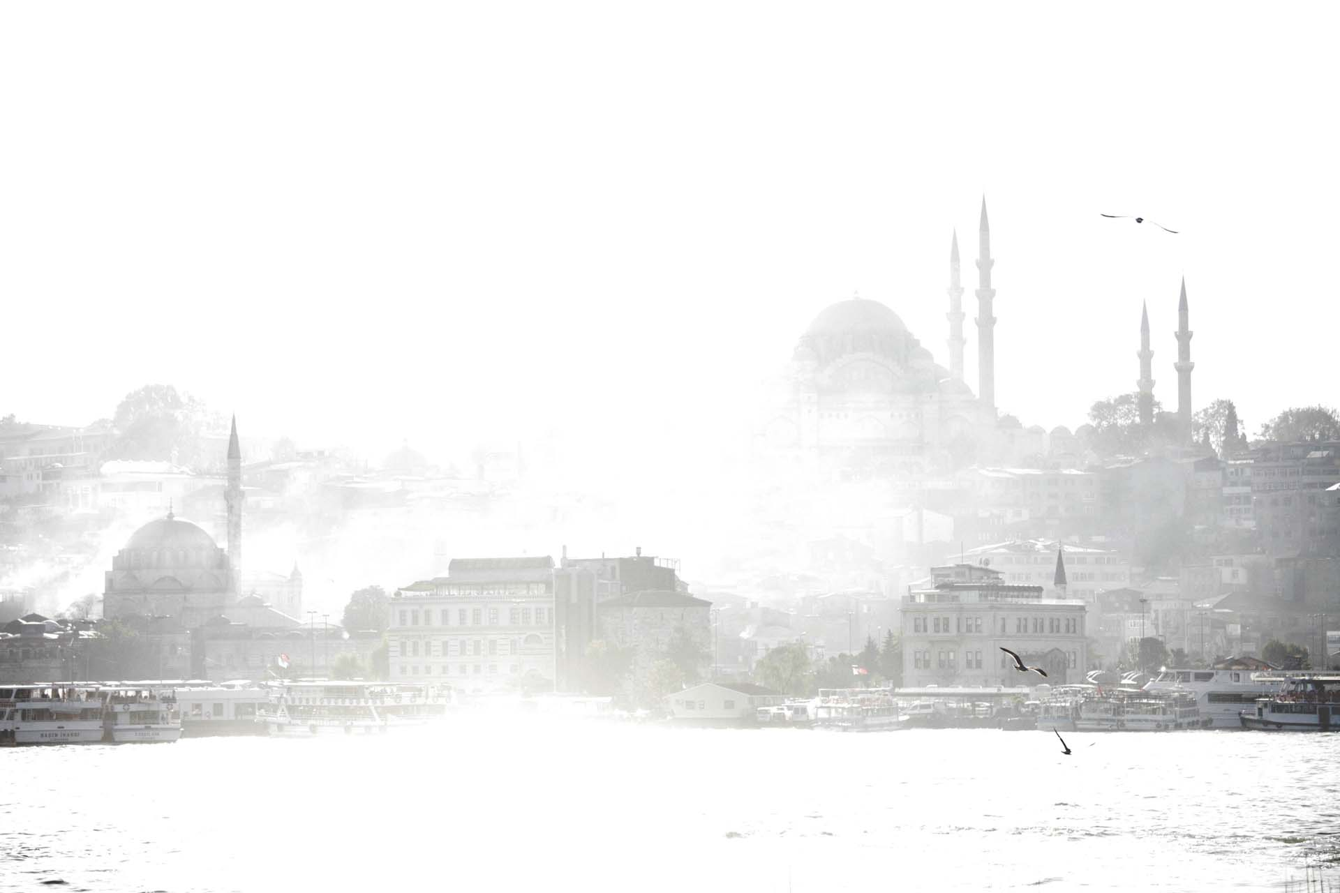The Süleymaniye Camii looks through the sun breaking morning fog