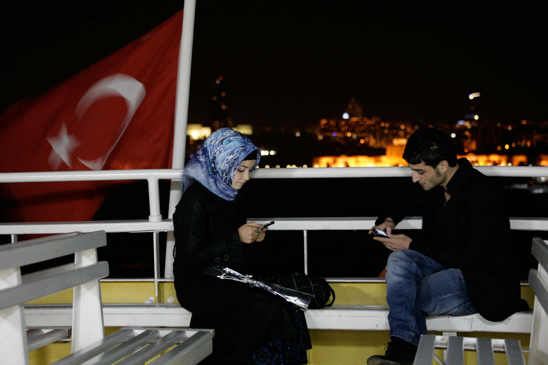 Time to check the phones on the Bosporus ferry to Eminönü