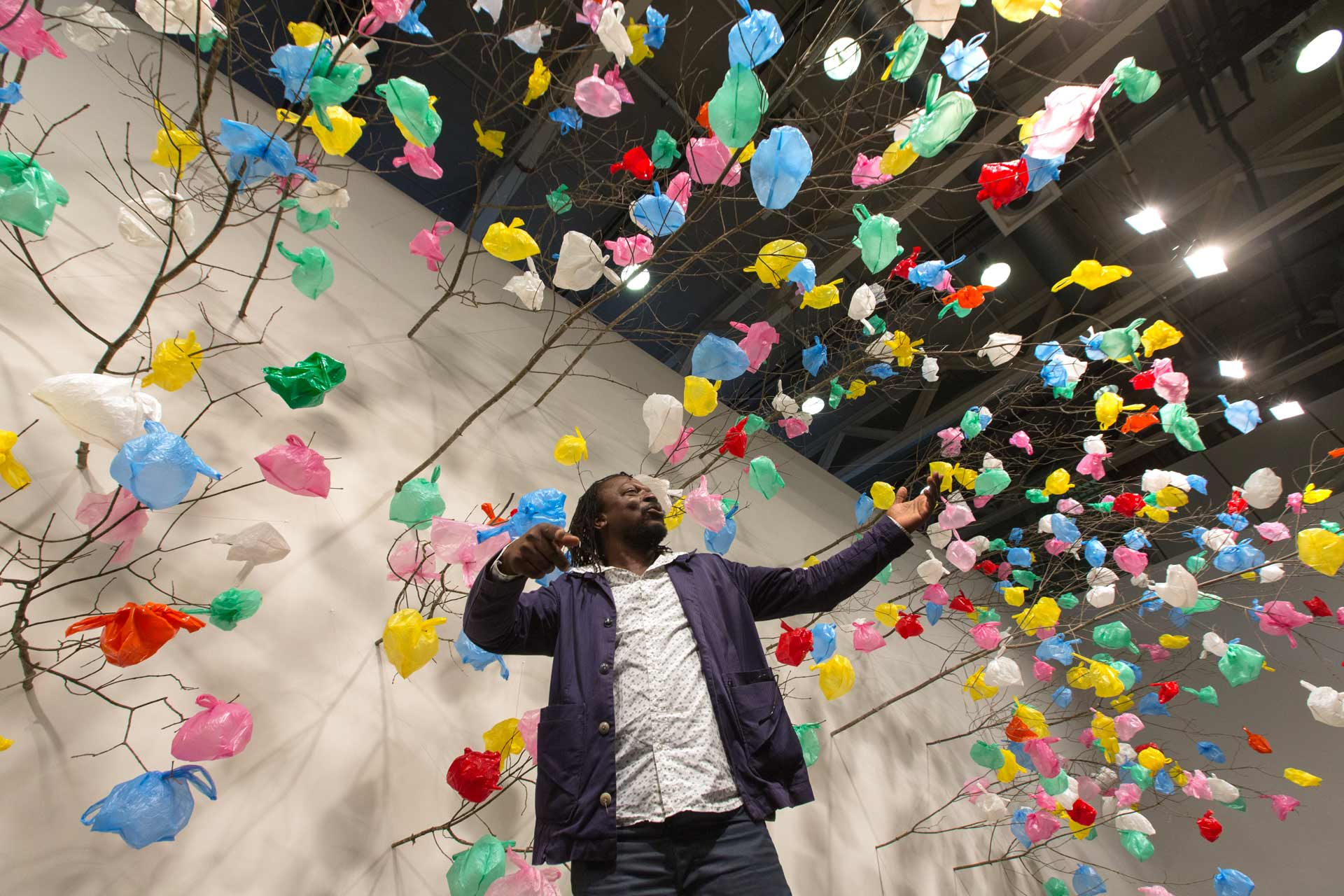"Art Unlimited 2015: Pascale Marthine Tayou – the artist at his installation, ""Plastic Tree"", 2014"