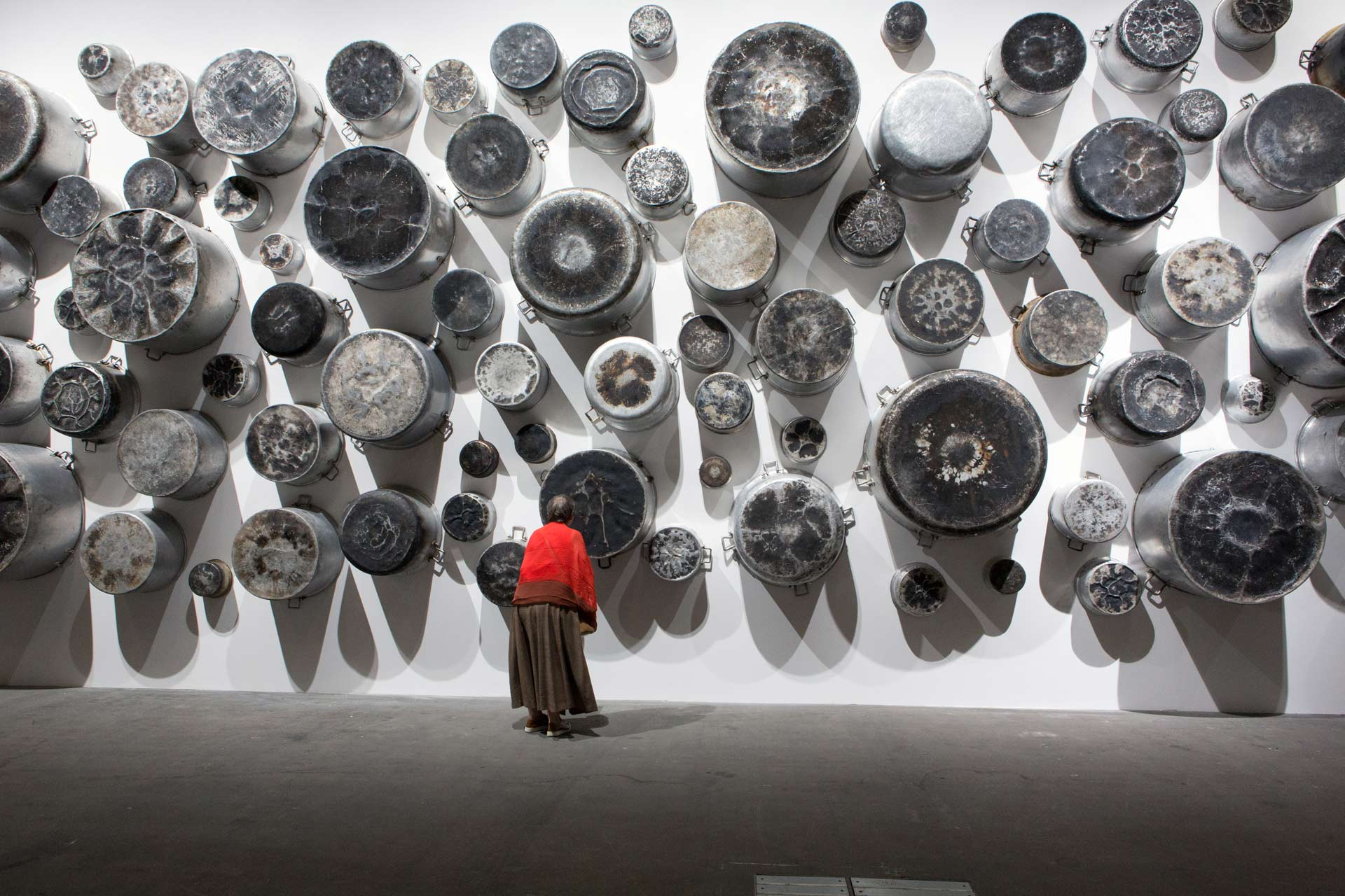 "Art Unlimited 2015: Maha Malluh, Food for Thought ""Almuallaqat"", 2014, installation with used aluminium cooking pots"
