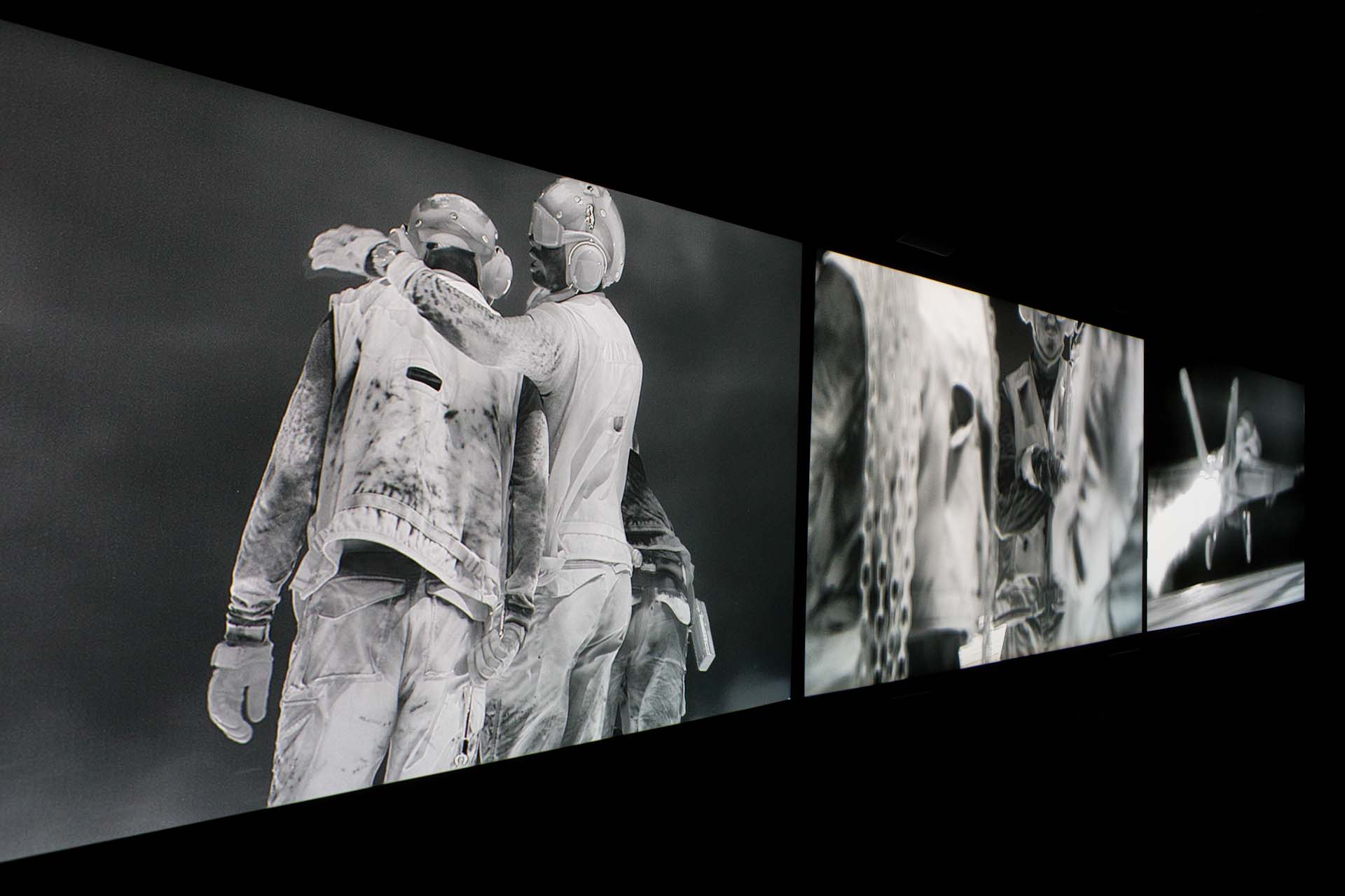 "Art Unlimited 2018: Richard Mosse, Incoming, 2016 (three-channel video installation) – ""Richard Mosse has developed a work that is bluntly aesthetic as well as political and ethical. Throughout his work, Mosse undermines armed photographic technologies by using them to confront the viewer and question documentary forms. Incoming is a critically acclaimed film installation created in collaboration with Ben Frost and Trevor Tweeten and commissioned by the National Gallery of Victoria, Melbourne, and the Barbican Art Gallery, London – R. Mosse is an Irish photographer and filmmaker, who immerses himself in his subject, integrating documentary journalism and art practice to explore issues of conflict, displacement and perception. He is one of only two photographers ever to have won both the Deutsche Borse Prize and The Prix Pictet, two of photography's most prestigious international awards. Richard is working on his latest award winning project, Heat Maps, a detailed documentation of Europe's refugee camps."" -  ""NGV Triennial 