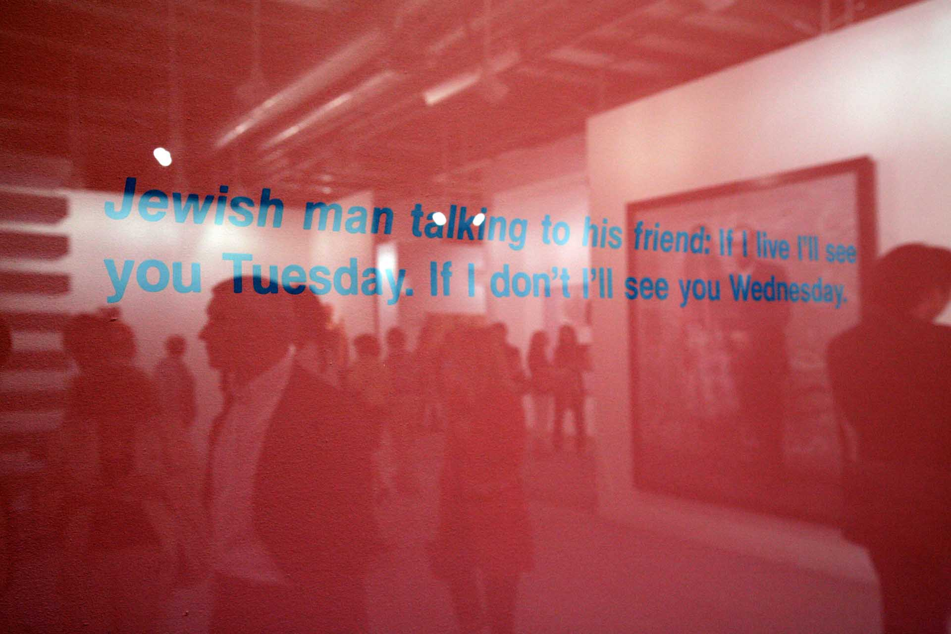 "Art 41, 2010: The bustling Art Basel is reflected in a work of art: ""Jewish man in conversation with his friend. If I'm alive, I'll see you Tuesday. If not, I'll see you on Wednesday."""