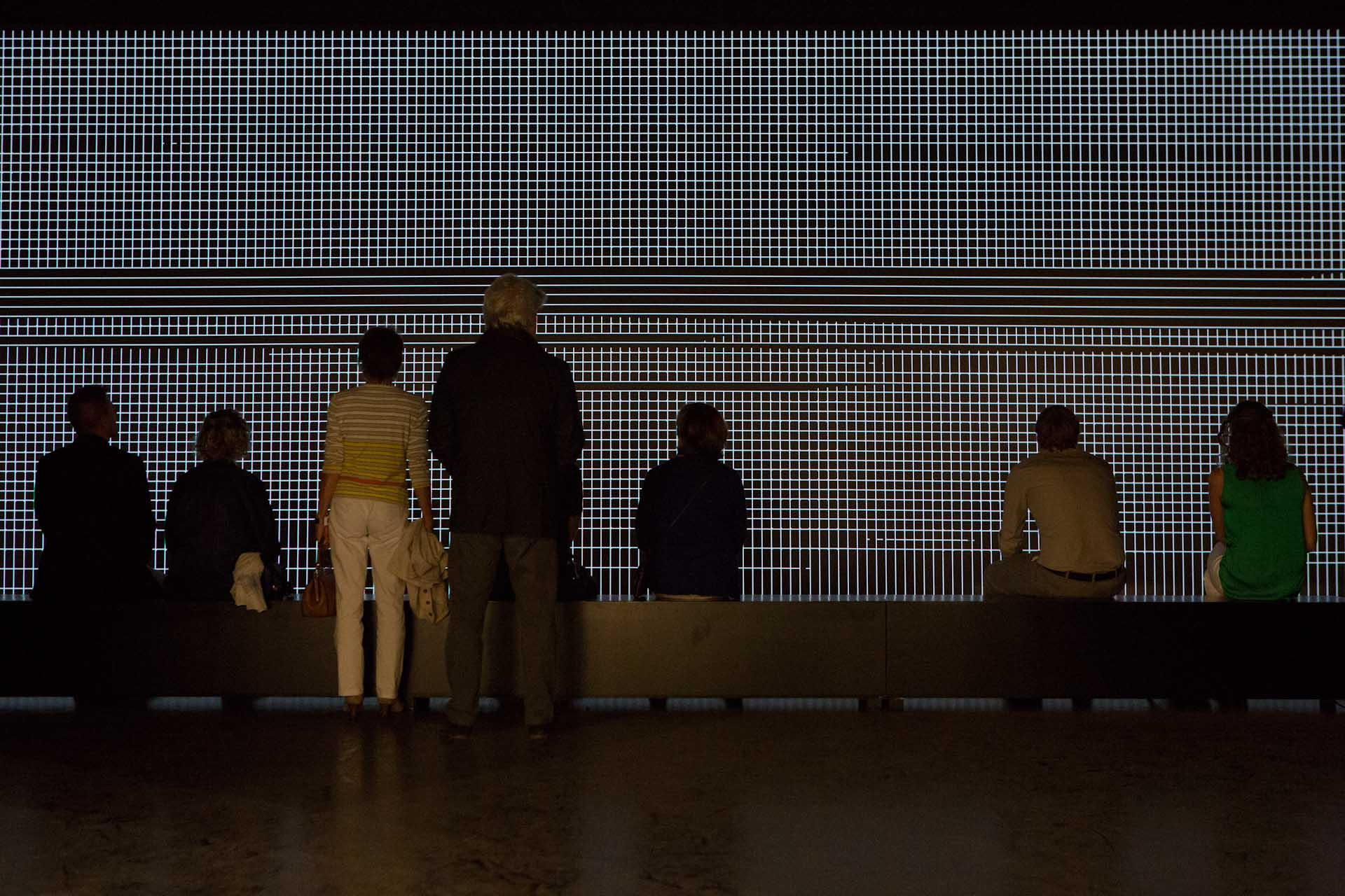 "Art Unlimited 2014: Visitors in front of a video installation by Carsten Nicolai: ""unidisplay"", 2012"