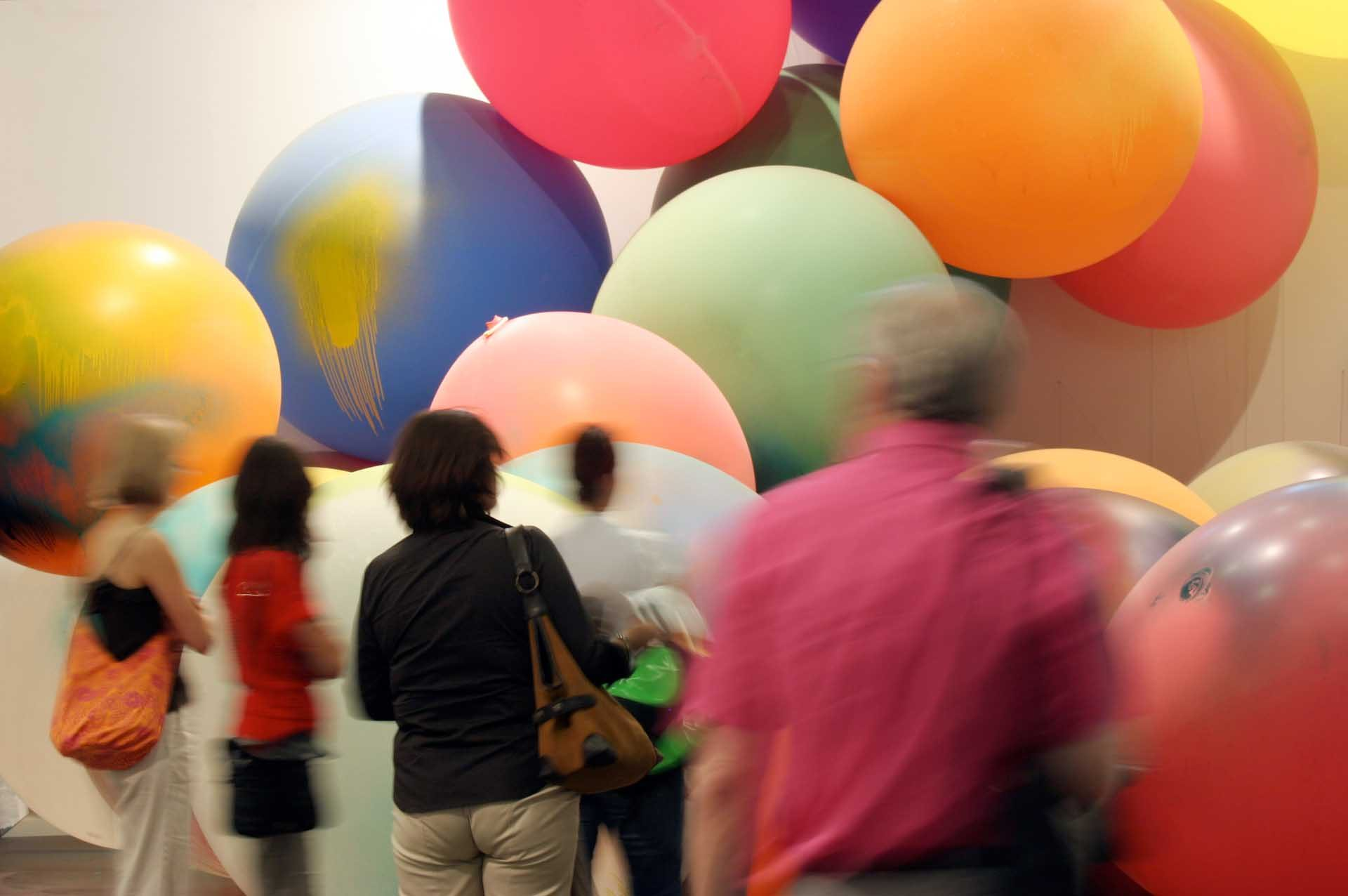 "Art 38 Unlimited, 2007: An installation with large coloured balloons and paintings by Katharina Grosse ""Atomimage"" from 2007"