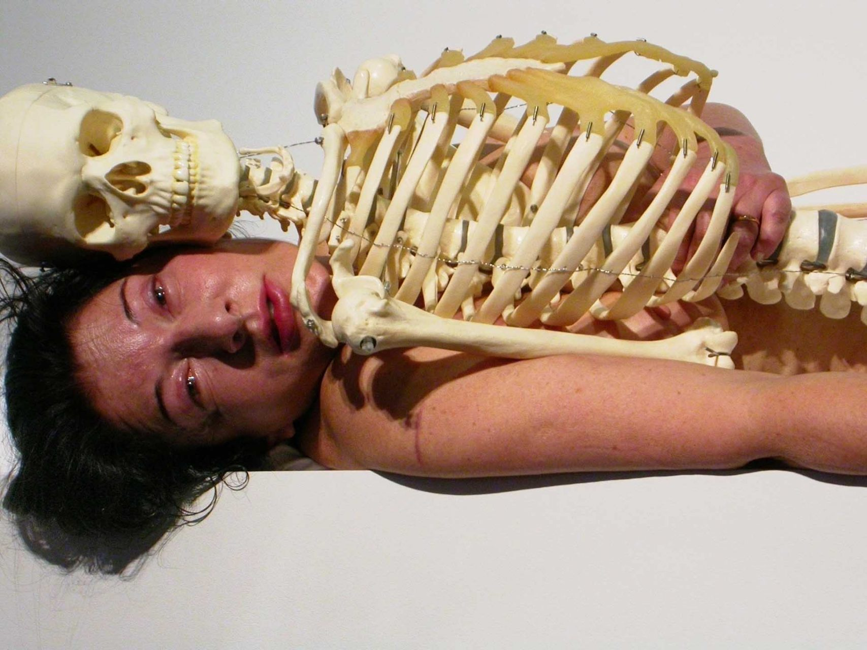 "Marina Abramovic during her performance ""Self Portrait with Skeleton"" at the opening of Art Unlimited 36 Basel, 2005"