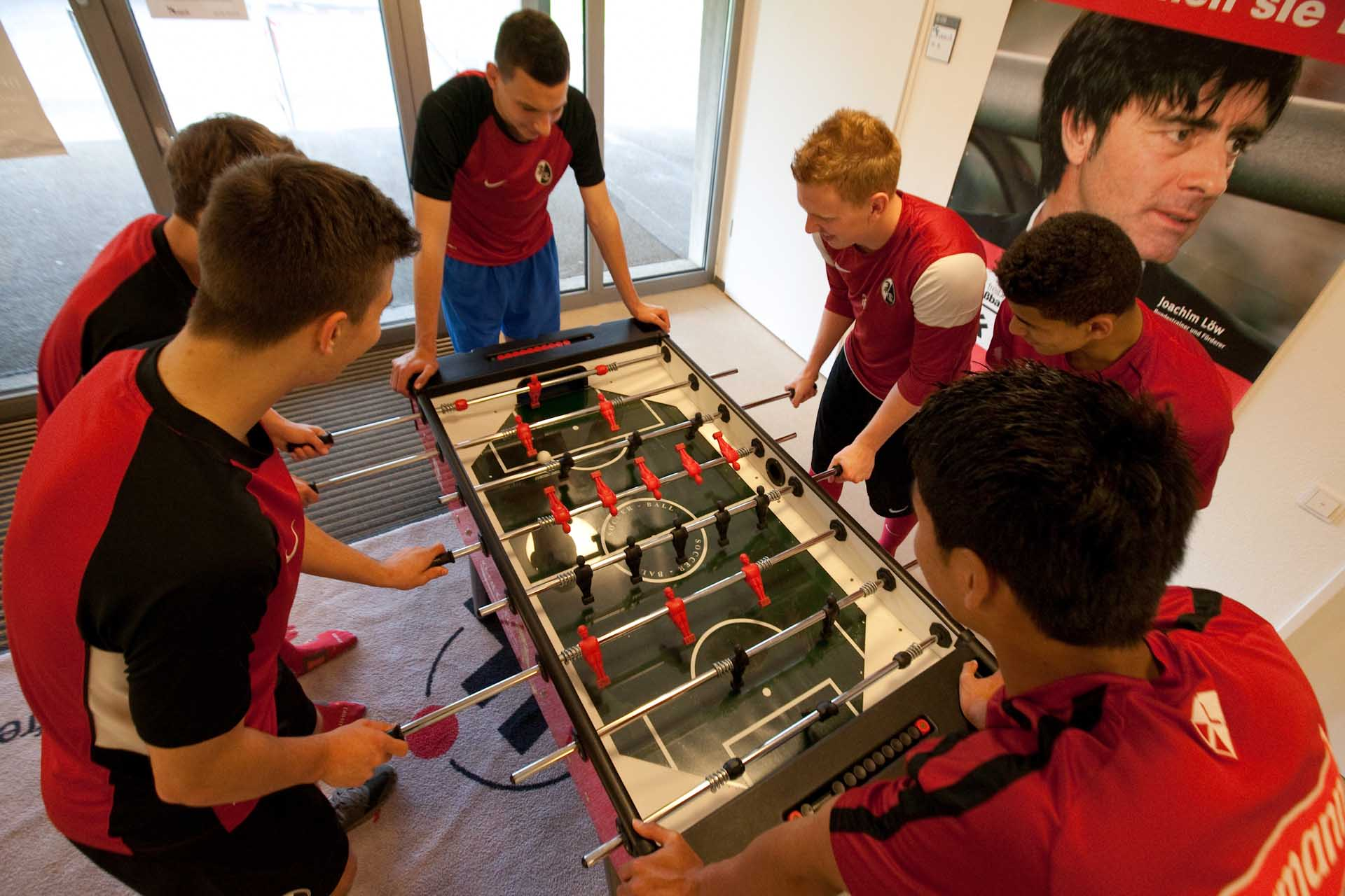 Youngsters play table football at Freiburg's academy