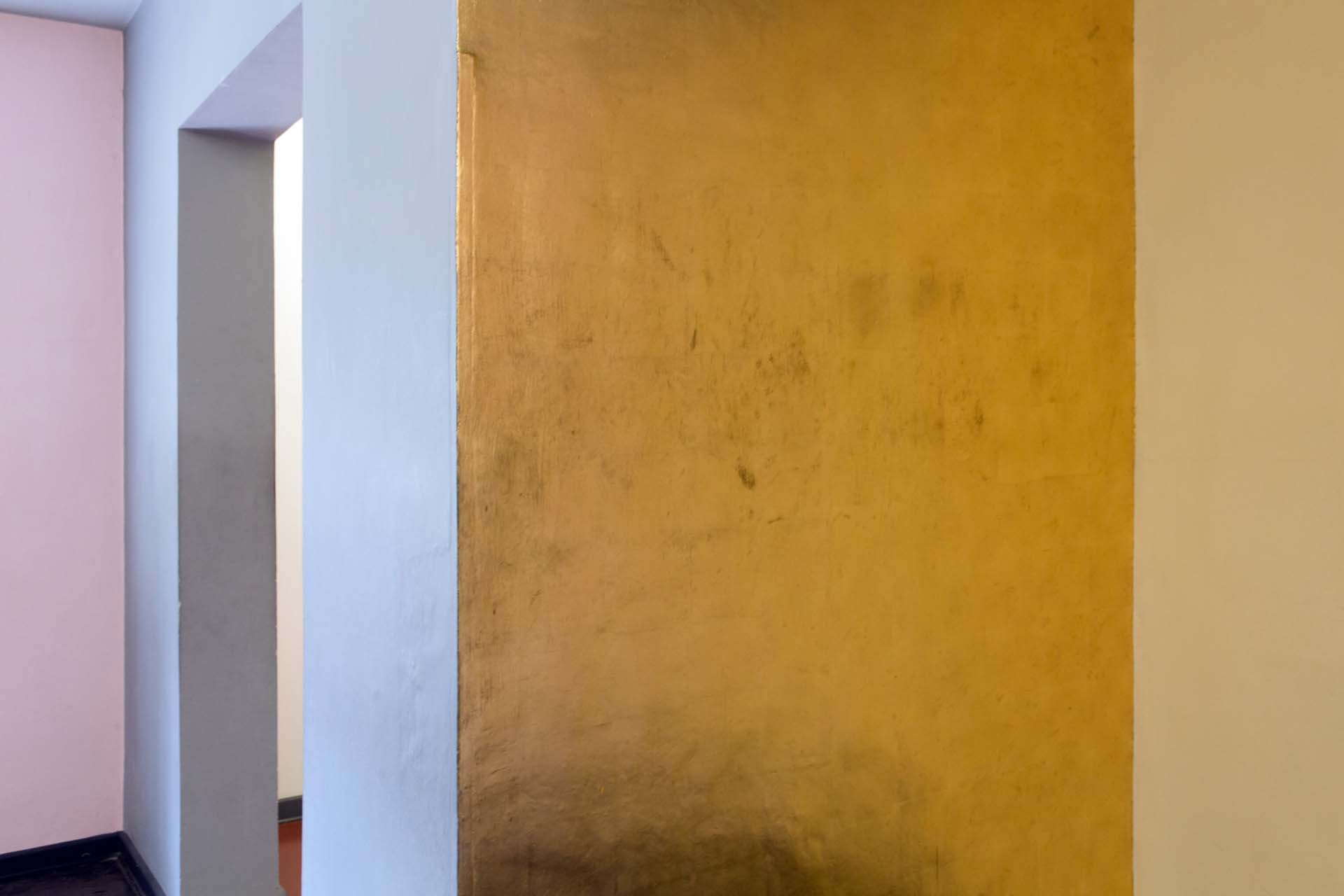 Gilded wall niche in the living room of the Dessau Kandinsky/Klee Master House. Wassily and Nina Kandinsky's gold wall piece made of impact metal was restored in 2003.
