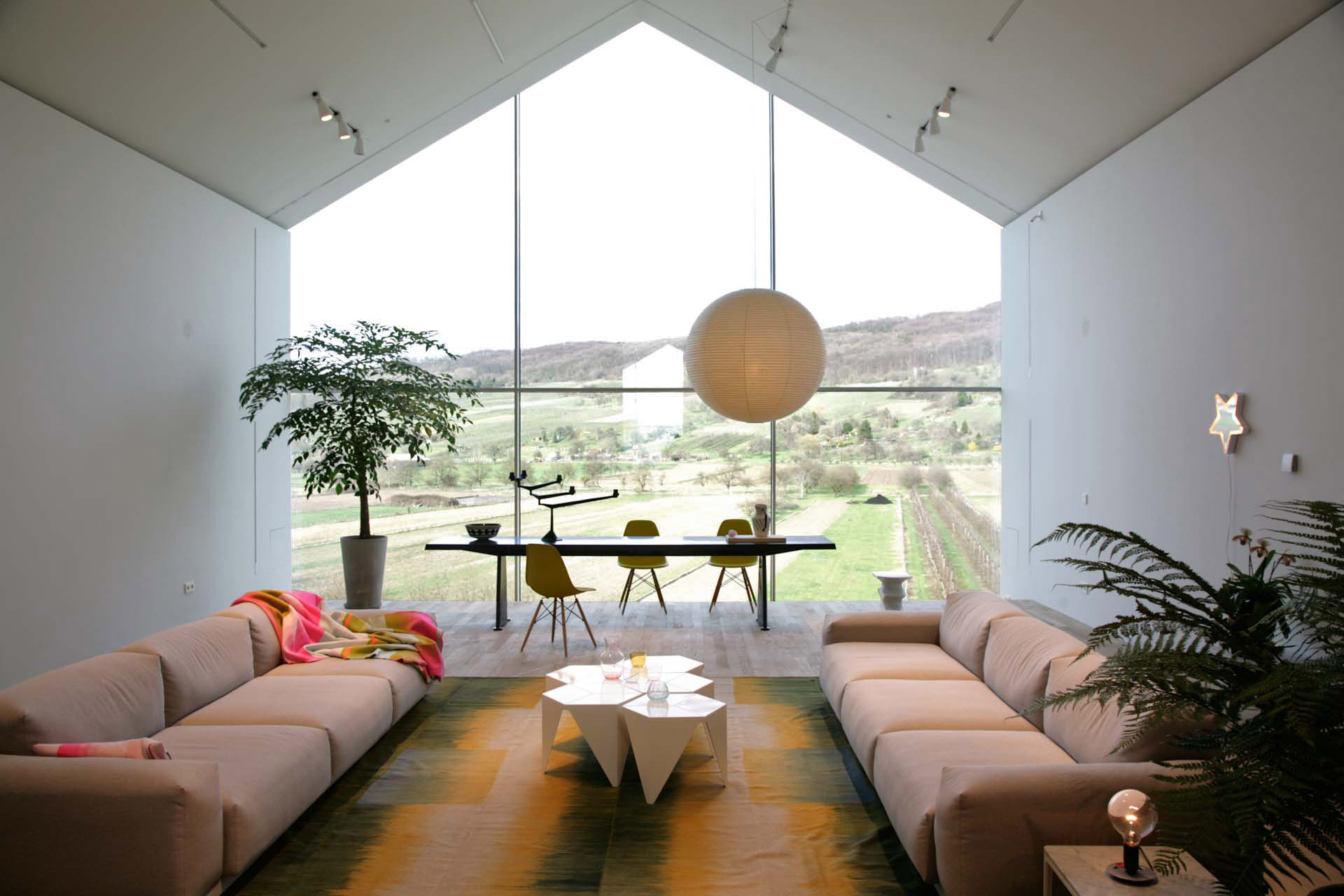 ...the Vitra Haus with big windows open to the nearby vineyards of the Tüllinger Hügel.