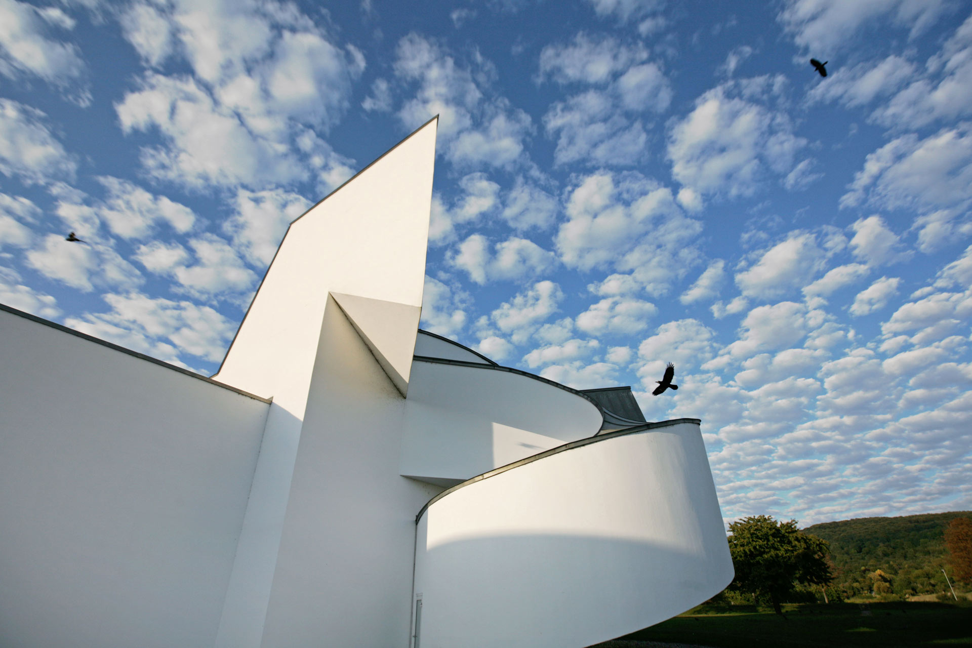 The Vitra Design Museum built in 1989 by Frank Gehry which was the first public building on the campus as well as the architect's first building in Europe.
