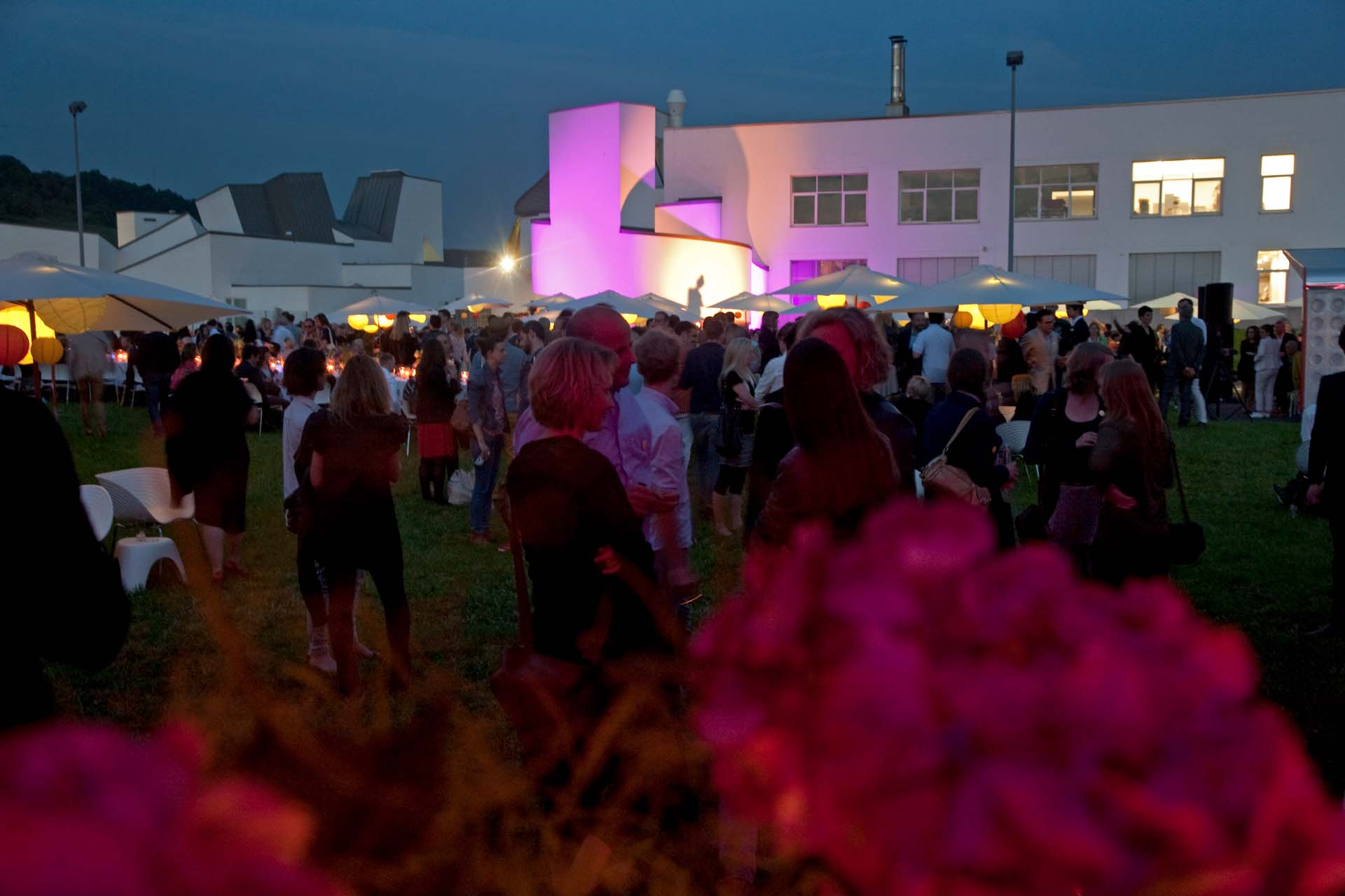 During the annual Vitra Summer Party. In the background the ensemble of the Vitra Design Museum and Vitra Office by Frank Gehry.